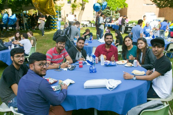 Students attending OPUS barbecue