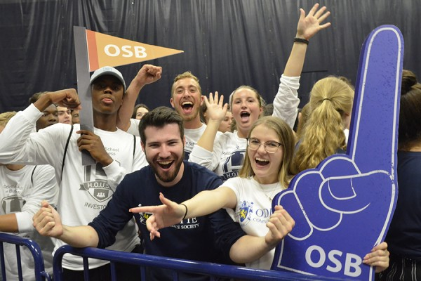 Representatives of the Odette School of Business cheer at an assembly welcoming first-year students to the University of Windsor, Wednesday in the Dennis Fairall Fieldhouse.