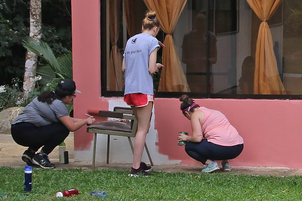 UWindsor students add a fresh coat of paint to the head office of the local water authority in Peñas Blancas.