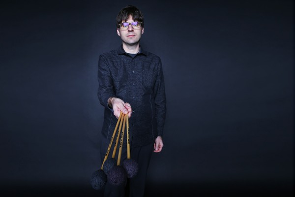 Nicholas Papador holding percussion mallets