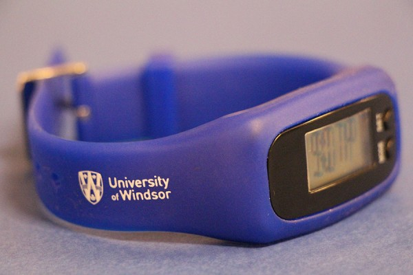 watch-pedometer with the UWindsor logo on its wristband