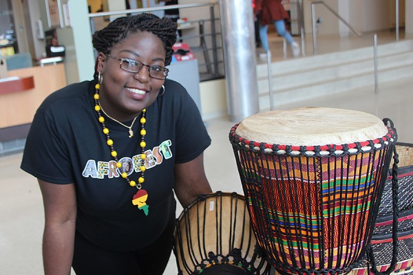 Afrofest patron Percyna Holder admires some of the handiworks on display during the cultural festival.