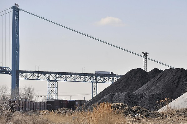 piles of petcoke pictured under Ambassador Bridge