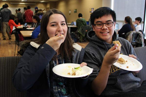 First-year students Kaity Greco and Matthew Tolentino enjoy free pie.