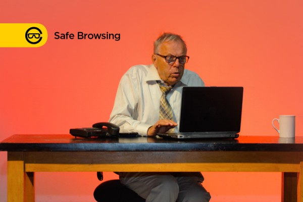man looking scared at computer