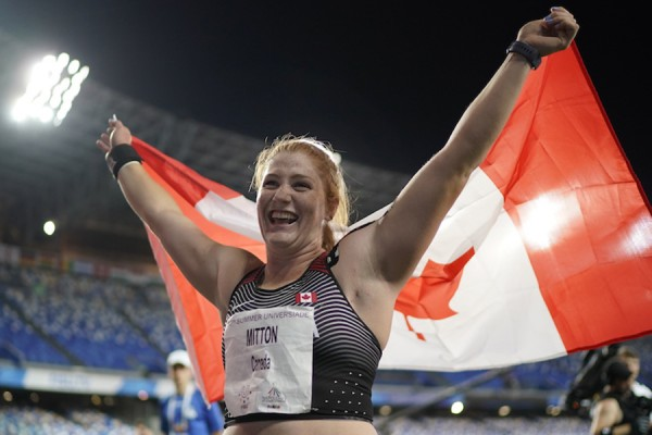 Sarah Mitton carrying Canadian flag