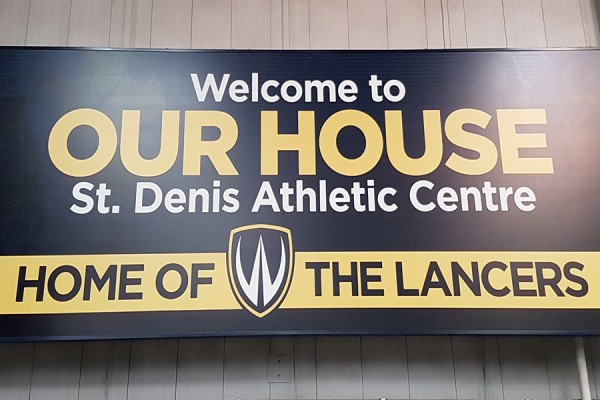 "Sign reading ""Our House, home of the Lancers"""