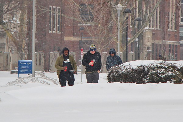 students walking in heavy snow