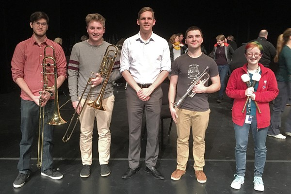 Trombonist Carter Gaus, trombonist Mackenzie Walsh, conductor Daniel Wiley, trumpeter Matthew Lepain, percussionist Sydney Brouillart-Coyle.