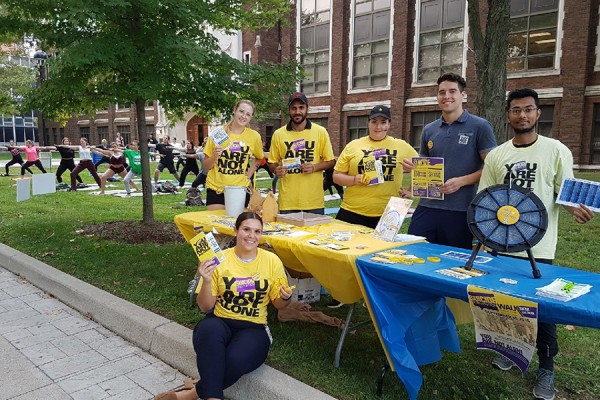 Student volunteers distribute literature on suicide prevention outside Dillon Hall.