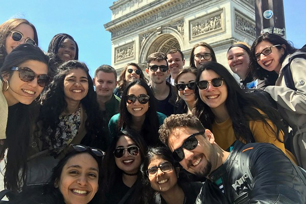 Shown here at L'Arc de Triomphe, students in the EU Study Abroad Program visited Paris as part of the course, accompanied by UWindsor professor Emmanuelle Richez.