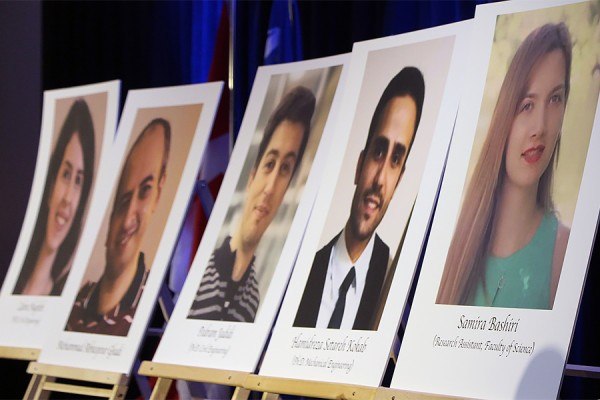 placards depicting people killed in plane crash
