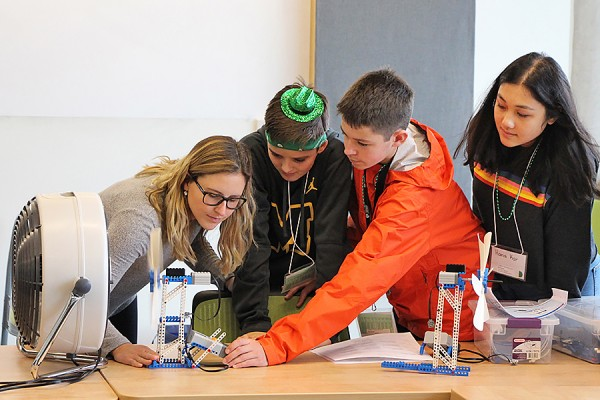 Participants in Take Our Kids to Work Day test the model wind turbine they built as an activity organized by the Faculty of Engineering.