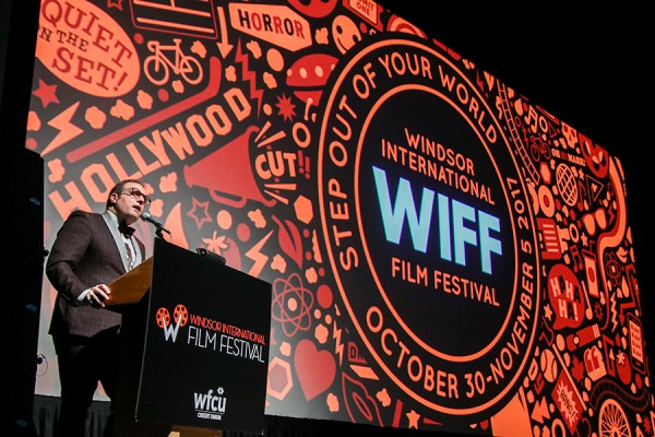 Vincent Georgie in front of screen at Windsor International Film Festival