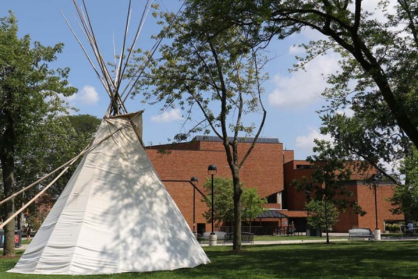 teepee pitched outside law building