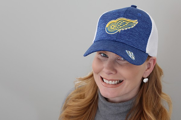 Marnie Robillard wearing blue and gold Red Wings cap