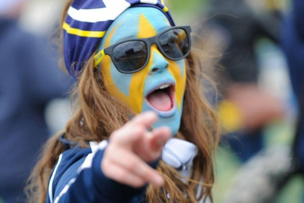 Student with face painted in blue and gold