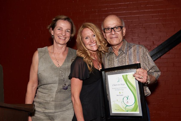 Lisa Porter (m.), Windsor Cancer Research Translational Research Director and Caroline Hamm (l.), WCRG Clinical Director present an award to Ron Truant, WCRG Executive Committee member, during WCRG's Cheers to Hope event. Photo courtesy of Snapd.