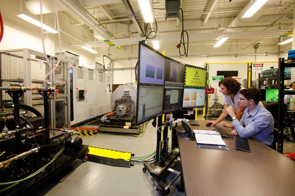 Researchers in UWindsor's Centre for Hybrid Automotive Research and Green Energy work on a state-of-the-art EV electric motor test system.