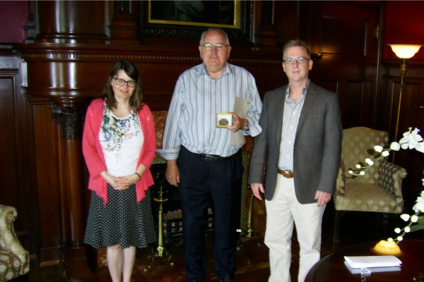 Local historian Arthur Jahns (centre) who received the 2015 UWindsor History Department Community Heritage Medal, accepted congratulations from the History Department professors' Miriam Wright (l.) and Steven Palmer (r.).