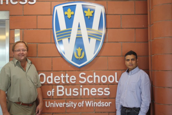 Odette School of Business professors, Dave Bussiere (l.) and Gokul Bhandari (r.) were successful in a Wharton Customer Analytics Initiative (WCAI) competition for access to an extensive database from a major international travel & tourism company.
