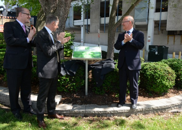 Mark Chauvin of TD Bank Group (r.), Windsor Mayor Drew Dilkens (l.), UWindsor President and Vice-Chancellor Alan Wildeman (left-center) unveiled a new sign, marking the green space on Chatham St. as the TD Chatham Street Parkette, June 2.