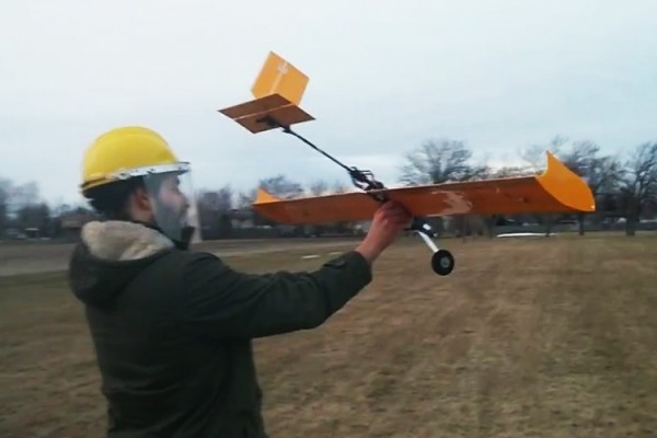 Mitchell Campbell, mechanical engineering student, launching UWindsor's aircraft at the SAE Aero Design West Collegiate Competition.