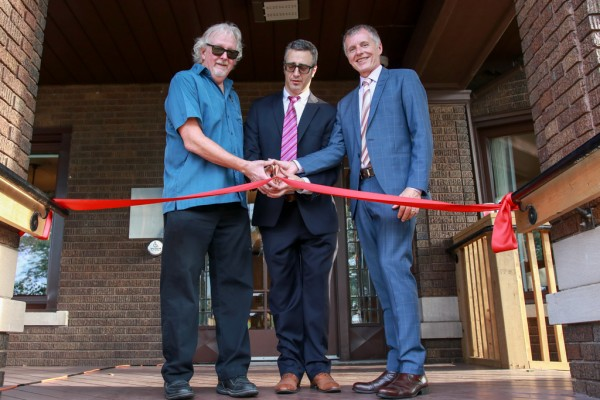 UWindsor Psychology Department Head Dennis Jackson, PSRC Director Antonio Pascual-Leone and University President Alan Wildeman cut the ribbon at the grand opening of the Psychological Services and Research Centre on Sept. 21, 2017.