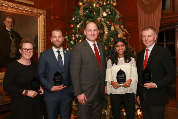 The University of Windsor's Sarah Woodruff Atkinson, Austin Roth, Anshika Jain and Alan Wildeman pose with Windsor Mayor Drew Dilkens after accepting their Mayor's Awards on Dec. 19, 2017.
