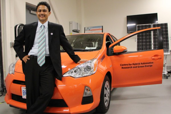 Narayan Kar with orange Prius