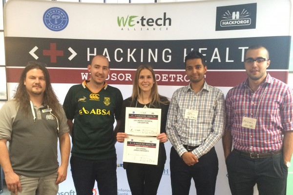 Nursing alumna Kaitlyn Sheehan (m.) and team, at Windsor-Detroit Hacking Health event.