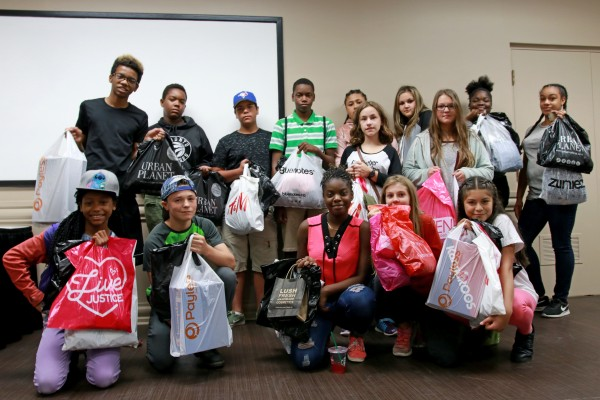 Participants of United Way's On Track To Success pose with their purchases at Devonshire Mall on Thursday, Aug. 24, 2017.
