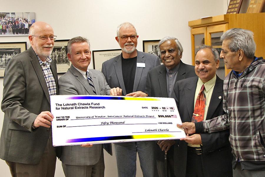 Jeff Berryman, Douglas Kneale, Phil Dutton, Datta Pillay, and Siyaram Pandey accept a gift from donor Loknath Chawla
