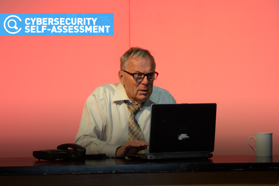 man looking frazzled with computer