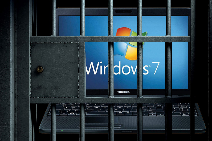 A Windows computer behind bars, as if in jail.