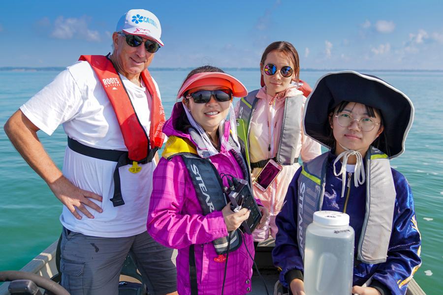 Hugh MacIsaac accompanies students from China's Yunnan University on a boat trip