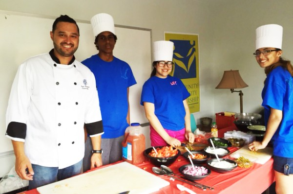 From left to right: At Libro Community Café's recent event, Executive Chef Paolo Vasapolli, worked with Balal Mohamed, Vivian Hui and Veronica Miller to prepare fish tacos with pickled red cabbage, and served the meals to the community.