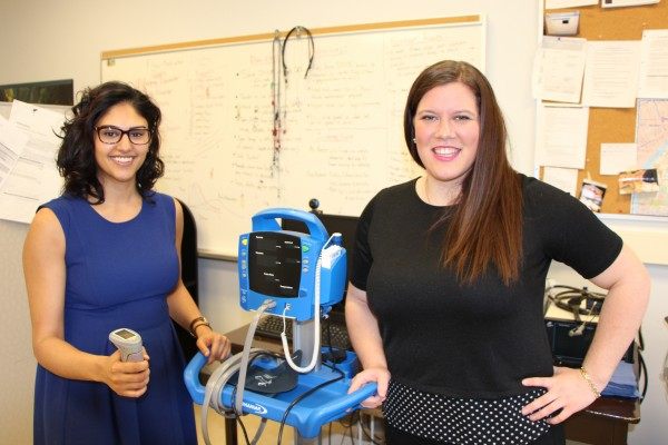 Research assistants Yasina Somani (l.) and Kristin Mayrand's (r.) seek people with high blood pressure for study.