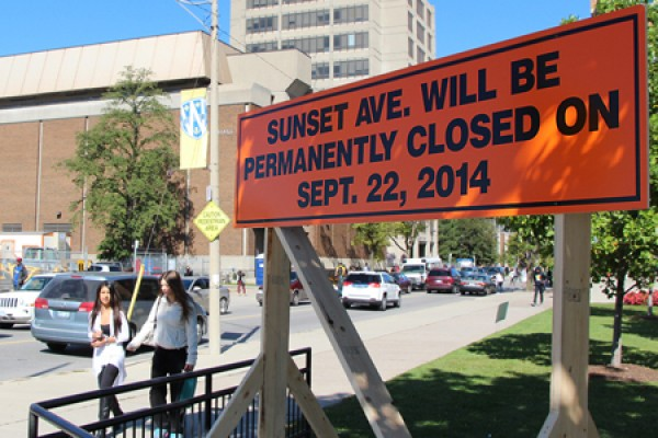 Sign announcing the pending closure of Sunset Avenue between Wyandotte and University streets.