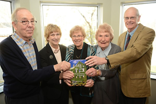 The editors of a book of UWindsor reminiscences celebrate its official launch Friday.