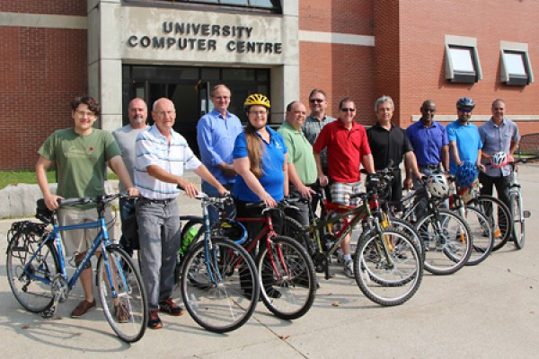 bikers pose in front of the University Computer Centre