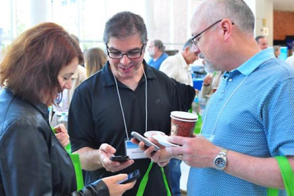 Ramona Codreanu, Domenic Panetta and Noah Diesbourg explore smartphone functionality during a break in Campus Technology Day 2014.