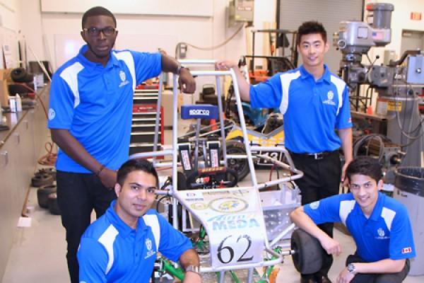 Students pose with the electric vehicle they helped to design and build.