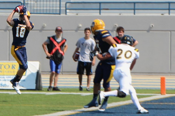 Receiver Evan Pszczonak hauls in a touchdown pass