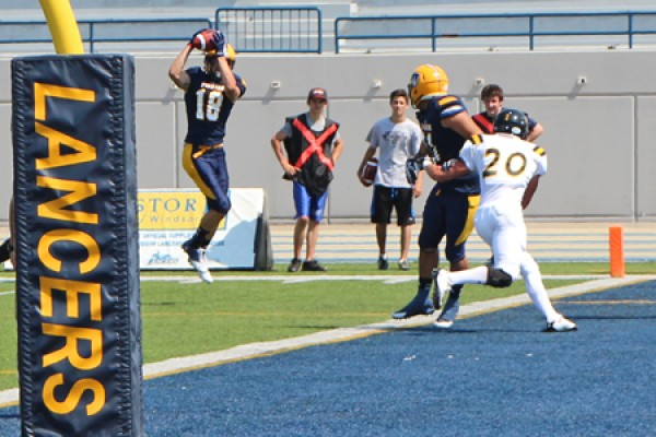 Receiver Evan Pszczonak hauls down a touchdown pass.