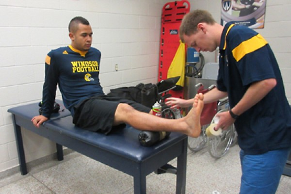 Adam Gaunt readies to tape Tarrance Crawford's ankle.