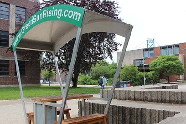 Green scene: The solar bench—which uses the sun's rays to charge electronics—frames a recycling station, a bicycle rack and the Stewart Moore Carolinian Garden to point up the University of Windsor's commitment to environmental responsibility.