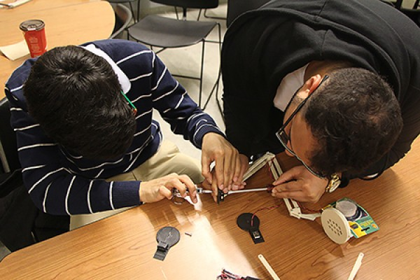 Humoud Alhumoud and Khalid Alharbi make last-minute adjustments to their USB lamp