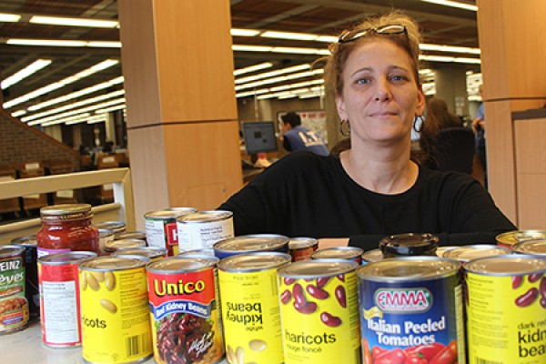 Joann Kolonelos poses with canned goods