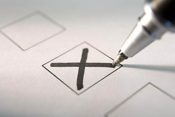 pen marking ballot with X